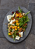 Bean salad with rocket, beetroot, feta cheese and polenta croutons