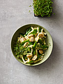 Pasta salad with mushrooms and cress