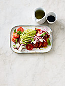 Tomato and avocado salad with mozzarella