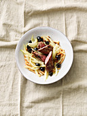 Lamb fillet with a fennel and olive medley