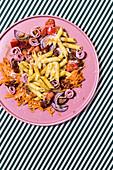Colourful pasta salad with ham