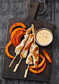 Satay skewers with oven-roasted pumpkin