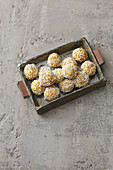 Apricot pralines with grated coconut