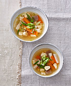 Dashi broth with knjac, tofu, radish and carrots (Japan)