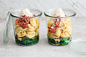 Tortellini soup with spinach and dried tomatoes