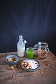 A healthy breakfast with muesli and a smoothie on a rustic wooden table