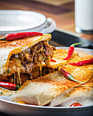 Mexican fajitas with grilled beef and red chillies