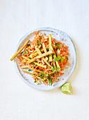 Fried tofu on a carrot and peanut salad