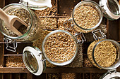 Various cereals in glass jars (oats, buckwheat, rye, wheat)