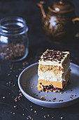 Cake with layers of dulce de leche, coconut meringue and coffee frosting