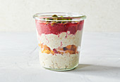 Raspberry overnight oats in a glass
