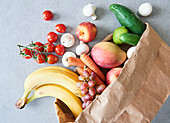 Weekly shopping: fresh fruit and vegetables in a paper bag