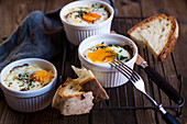 Oeufs cocotte with spinach, bacon and feta