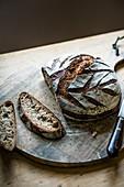 Freshly made sourdough loaf on a chopping board, sliced