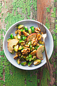 Lukewarm brussels sprout salad with apple and caramelized walnuts