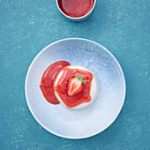 Mini semolina pudding with strawberry sauce