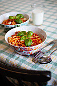 Spaghetti Pasta with tomatoe sauce and mozzarella basil