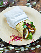 Vegetarian wrap with beans and red onion salsa