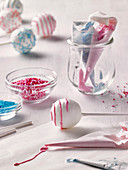 Decorating cake pops with icing and sugar sprinkles