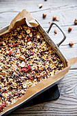 Muesli bar mixture in a tray