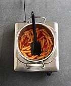 Pasta being stirred