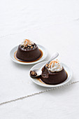 Bonet piemontese (chocolate and coffee puddings topped with cream and caramel, Italy)