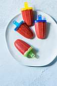Tomato and strawberry ice lollies with nutmeg and basil