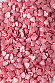 Pink sugar hearts as cake decoration