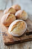 Homemade breakfast rolls on a wooden board