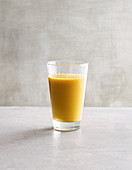 A vitamin-rich ACE smoothie with carrots, apple, banana and orange