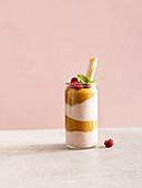 Peach melba smoothie dessert with Greek yoghurt