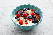 A breakfast bowl with fresh berries and chia seeds