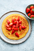Oat pancakes with almonds and strawberries