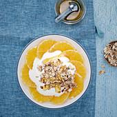 Fresh oranges with yoghurt and a muesli mixture