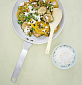 Colourful stir-fried courgettes with peppers and feta cheese