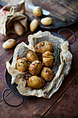 Hasselback potatoes in parchment paper