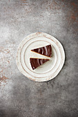 Two slices of chocolate tart on a plate