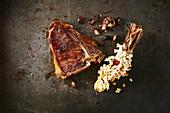 A T-bone steak and popcorn