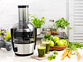 Green smoothies with apple, herbs and carrots