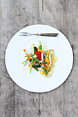 Green and yellow courgette noodles with colourful carrots