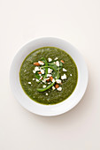 Cream of fennel and spinach soup with roasted feta cheese and almonds