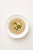 Cream of cauliflower soup with cannellini beans and pistachio nuts