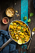 Cauliflower and green bean vegan biryani in a pan