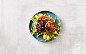 Celeriac and nut schnitzel with orange salad