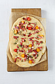 Moarwirtbrot (yeast flatbread) with bacon and cherry tomatoes