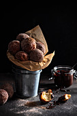 Homemade mini doghnuts coated in cinnamon and sugar with dipping chocolate sauce