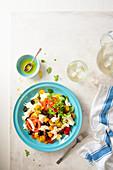 Italian mozzarella and tomatoes summer salad with black olives
