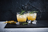 Pear and gin cocktails with rosemary
