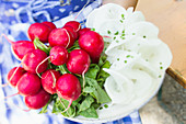 Radishes, sliced and whole