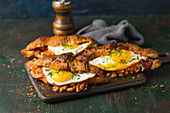 Croissants, baked with cheese, beans and fried eggs, sprinkled with parsley